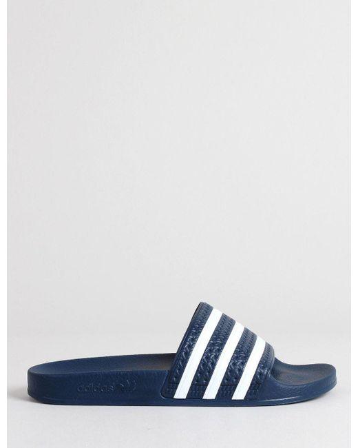 84425bcc74cc3e Adidas Originals - Adilette Slides - Adiblue   White for Men - Lyst ...