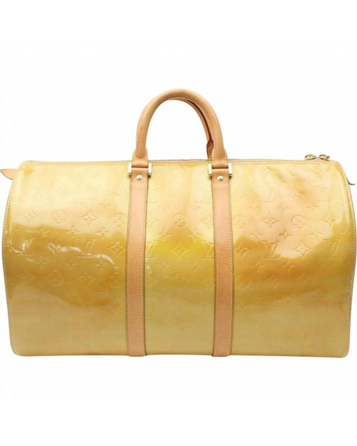 8b4b5d3c1619 Louis vuitton yellow vintage keepall yellow patent leather travel bag jpeg  520x650 Yellow louis vuitton travel