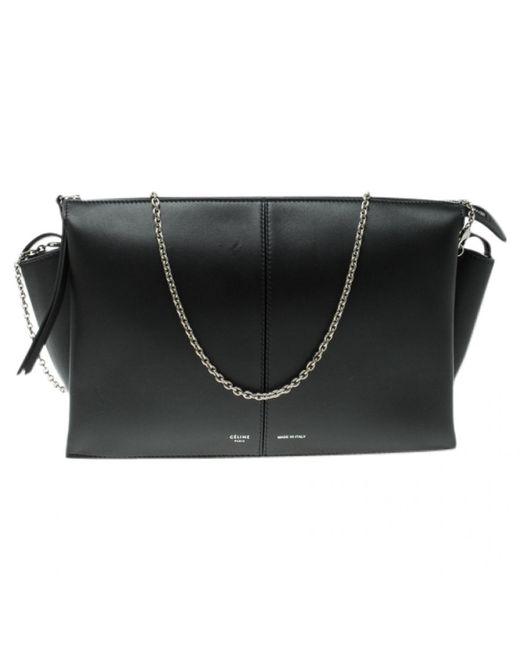 63adbc40c5d5 Céline Pre-owned Tri-fold Black Leather Clutch Bags in Black - Lyst