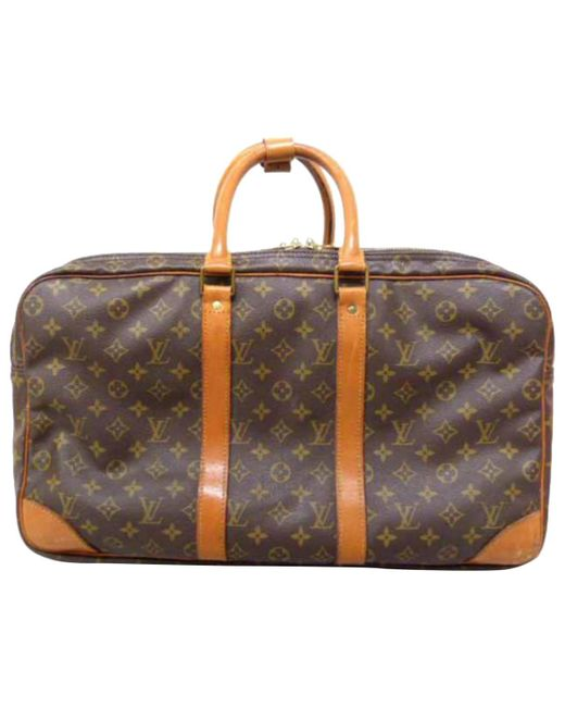 83085193671d Louis Vuitton Vintage Brown Cloth Travel Bag in Brown - Lyst
