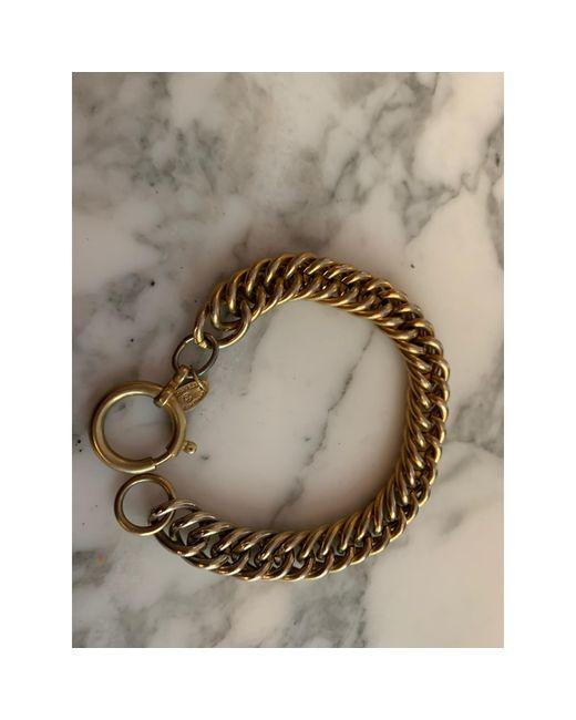 Bracelet métal doré Chanel en coloris Metallic