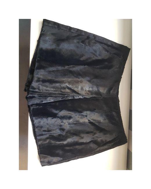 Short fausse fourrure noir Maje en coloris Black