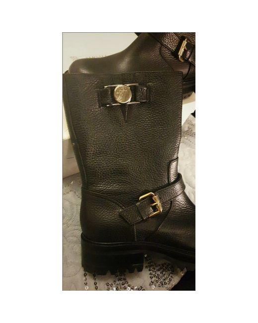 Bottines & low boots motards cuir noir Versace en coloris Black