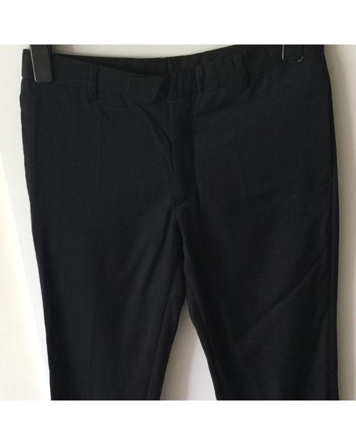 Pantalon carotte coton noir Sandro en coloris Black
