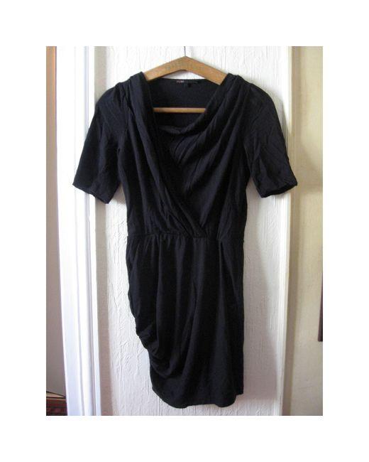 Robe mi-longue cuir noir Maje en coloris Black