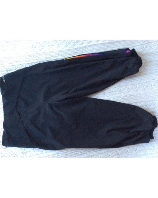 Pantalon de fitness viscose noir Nike en coloris Black