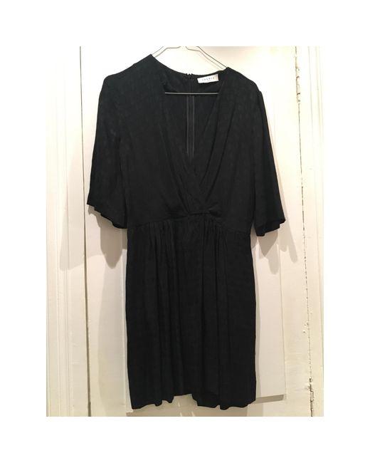 Robe courte soie noir Sandro en coloris Black