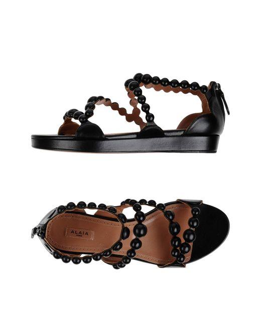 Alaïa - Black Sandals - Lyst
