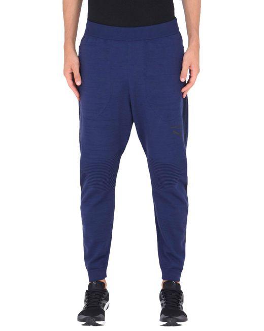 PUMA Pantalon homme de coloris bleu