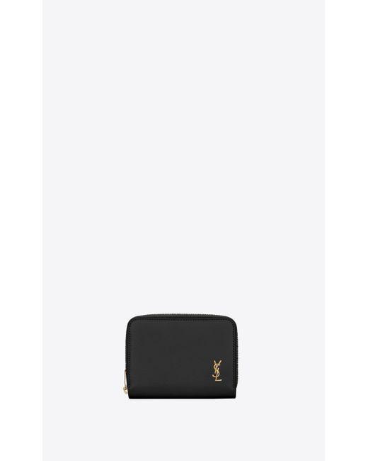 Portafogli monogram piccolo compatto con zip in pelle morbida di Saint Laurent in Black