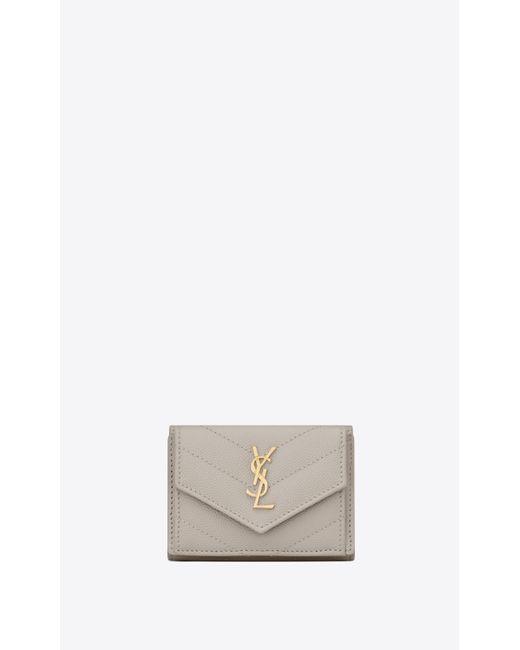 MONOGRAMME petit portefeuille enveloppe en cuir embossé grain de poudre Saint Laurent en coloris Multicolor