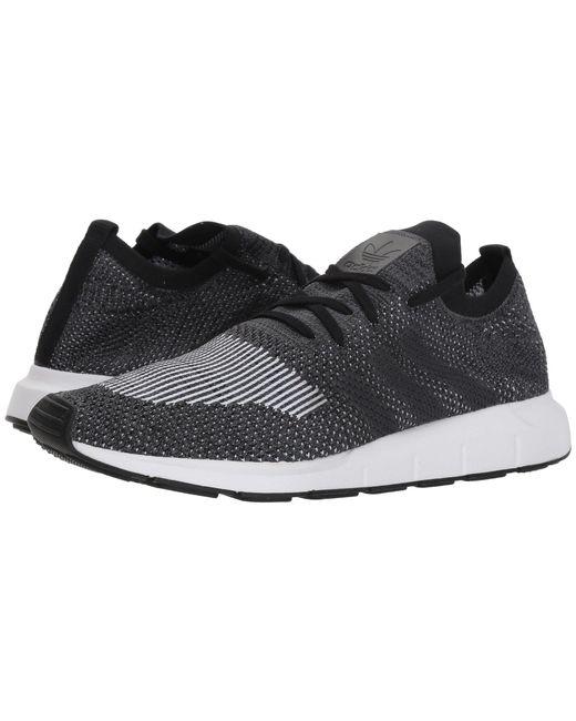 lyst adidas swift run pk (ftwwht / greone / cblack) scarpe da uomo in