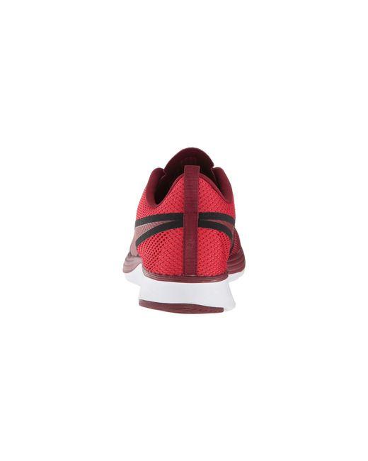b9aae2520dcd8 ... Nike - Zoom Strike 2 Running Shoe (university Red team Red black  ...