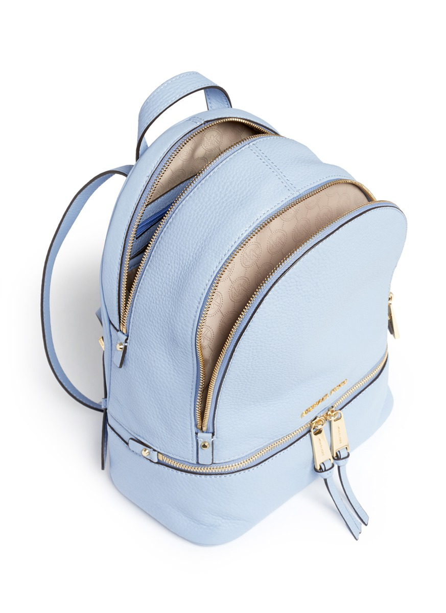 1436206b6ce6 ... shop michael kors rhea small 18k gold plated leather backpack in blue  3ba00 27288