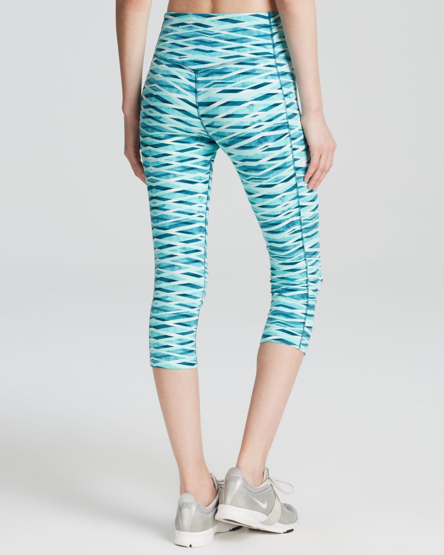 35f3f349a6dbc Nike Legendary Crisscross Capri Leggings in Blue - Lyst