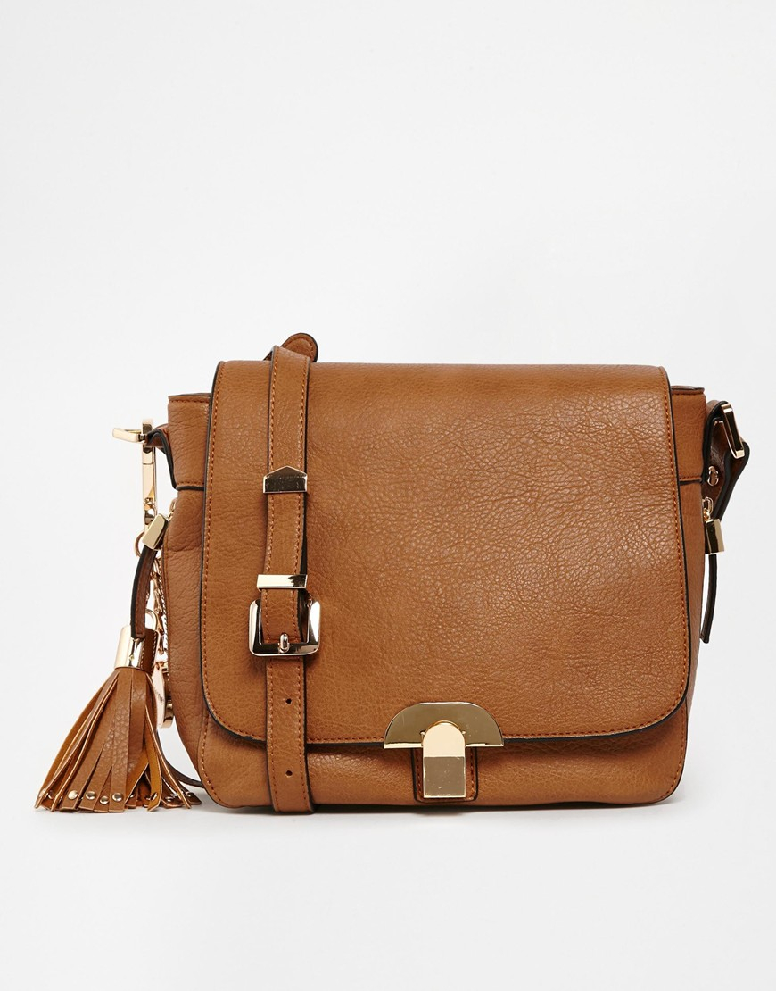 Dune Tan Cross Body Bag with Detachable Tassle in Brown | Lyst