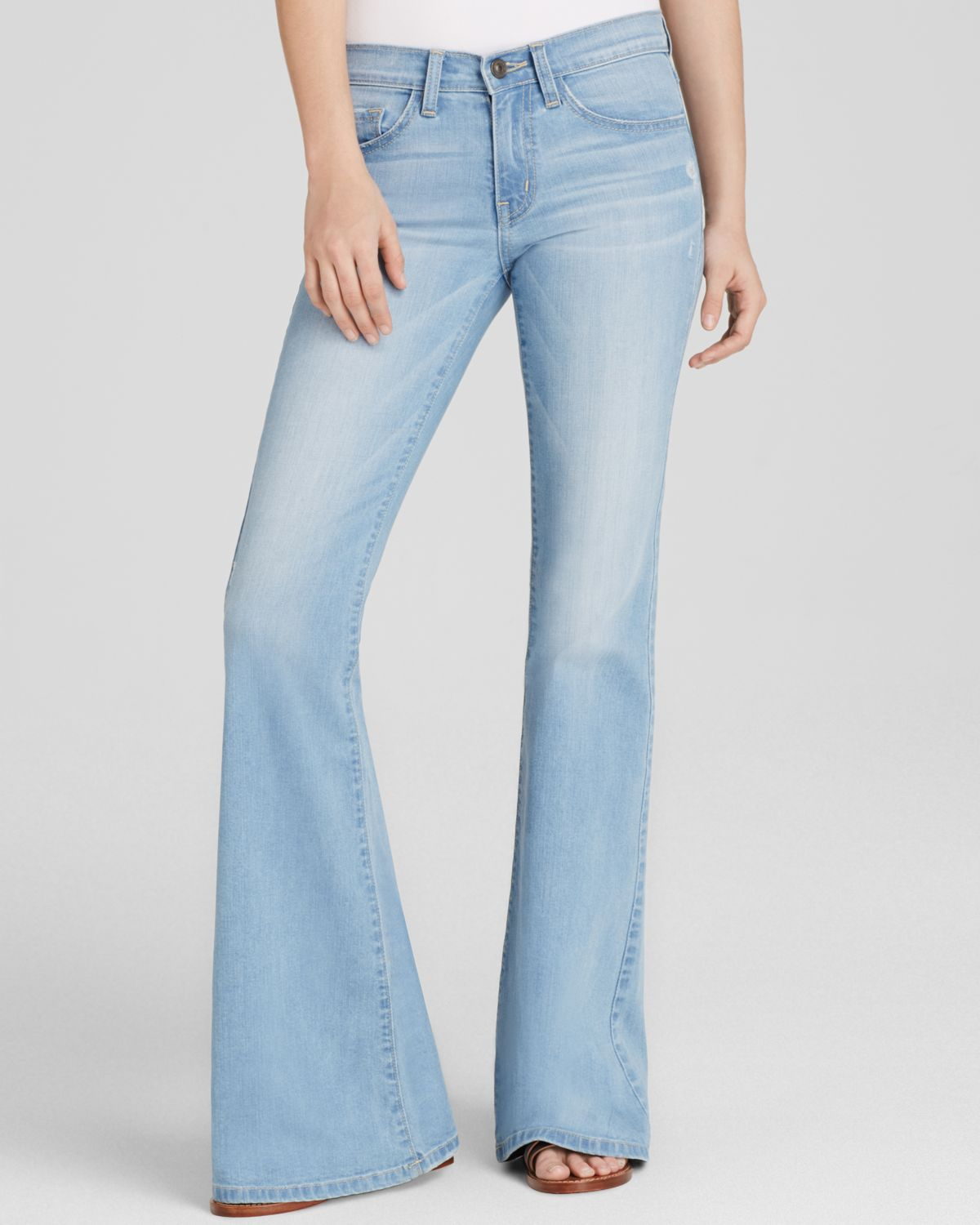 These high-waisted flared jeans feature a trendy raw hem. Shop rue21!
