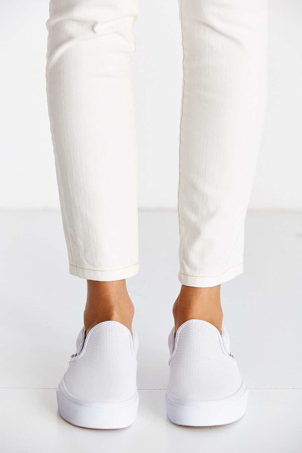 4030e215dc1 Lyst - Vans Perforated Leather Slip-on Sneaker in White