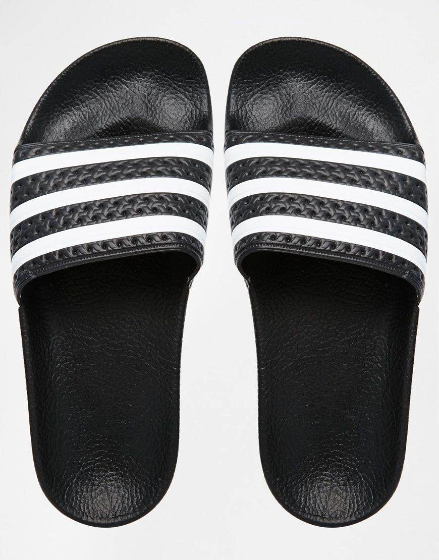 pretty nice 27dd7 e6be9 Lyst - adidas Originals Originals Adilette Black   White Stripe Slider  Sandals in Black