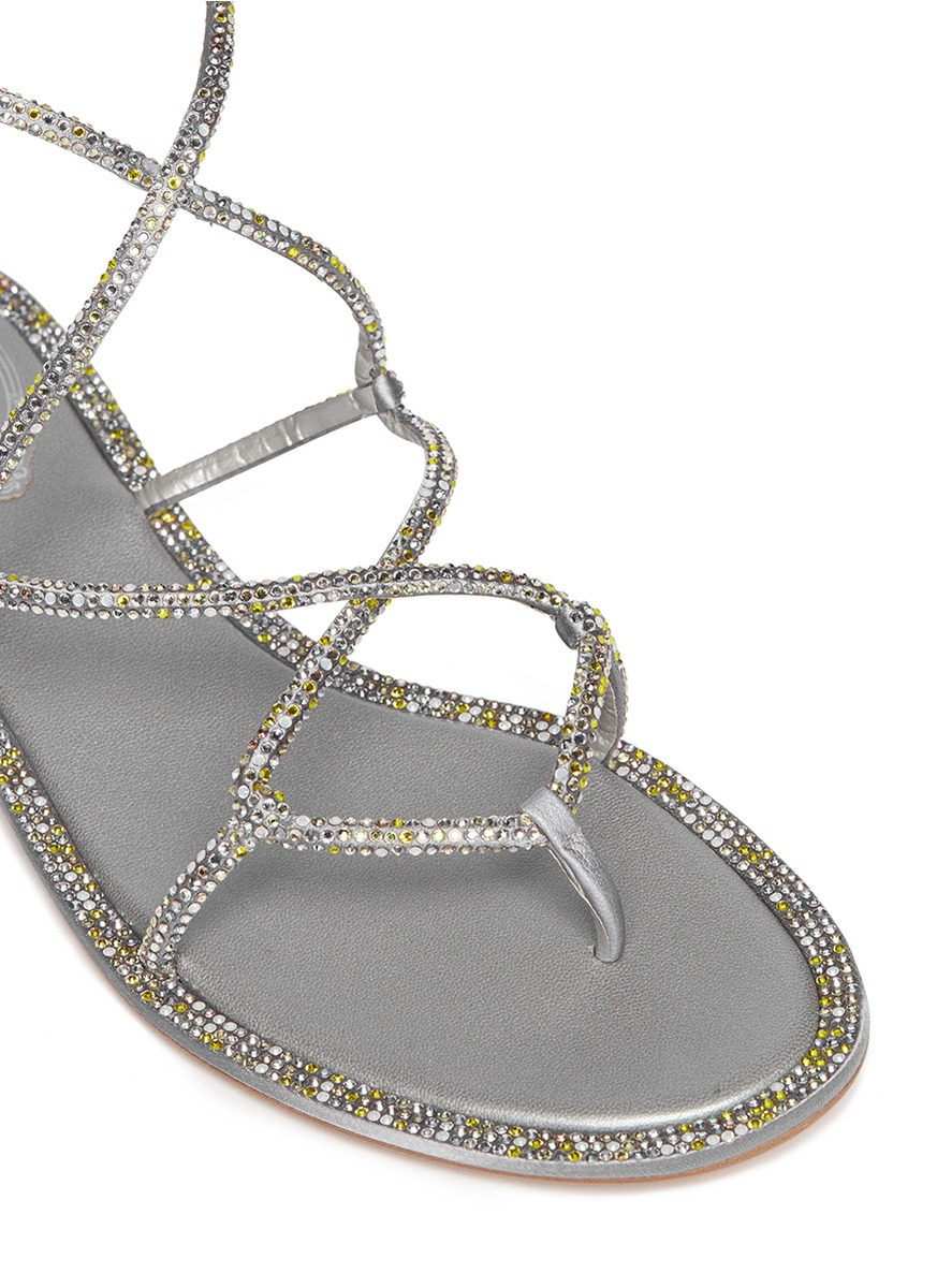 43d1016dd9aee3 Lyst - Rene Caovilla Crystal Cross Strap Flat Sandals in Metallic