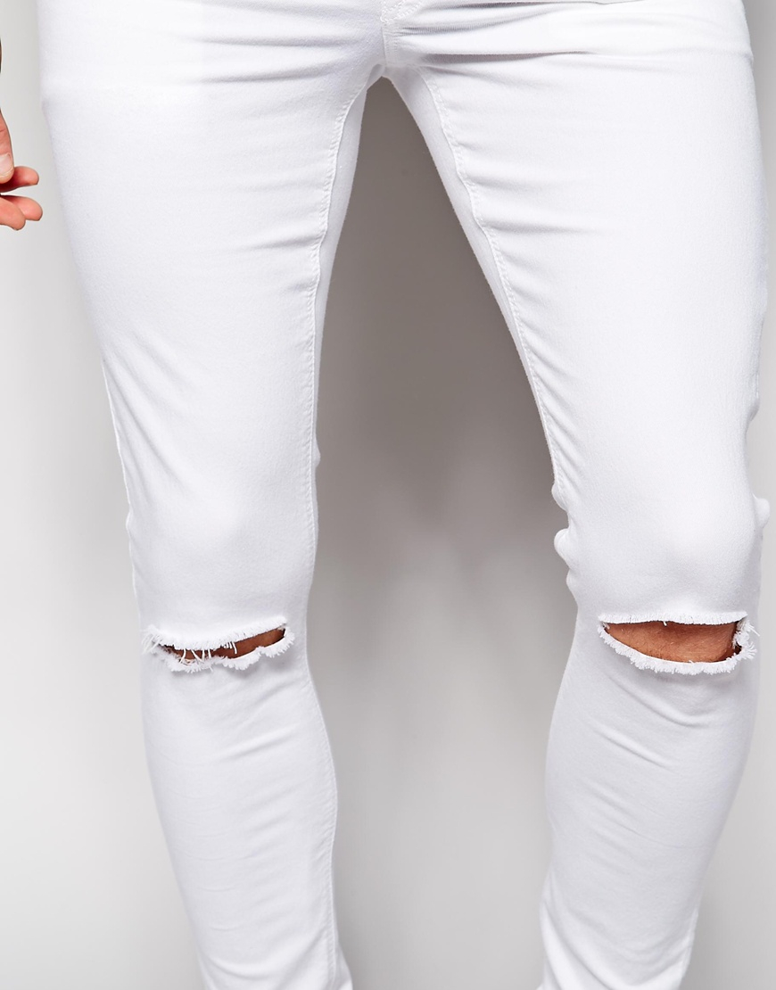 Skinny jeans with knee slits