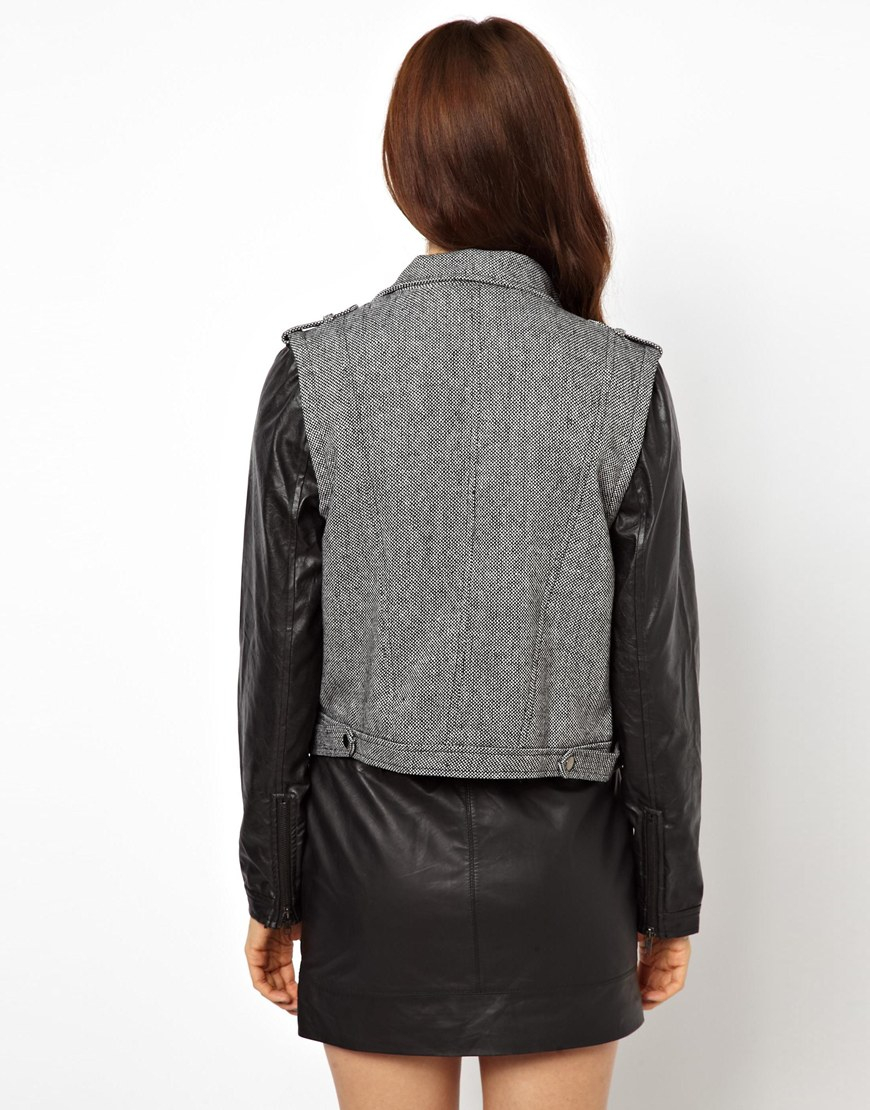 Grey jacket with leather sleeves