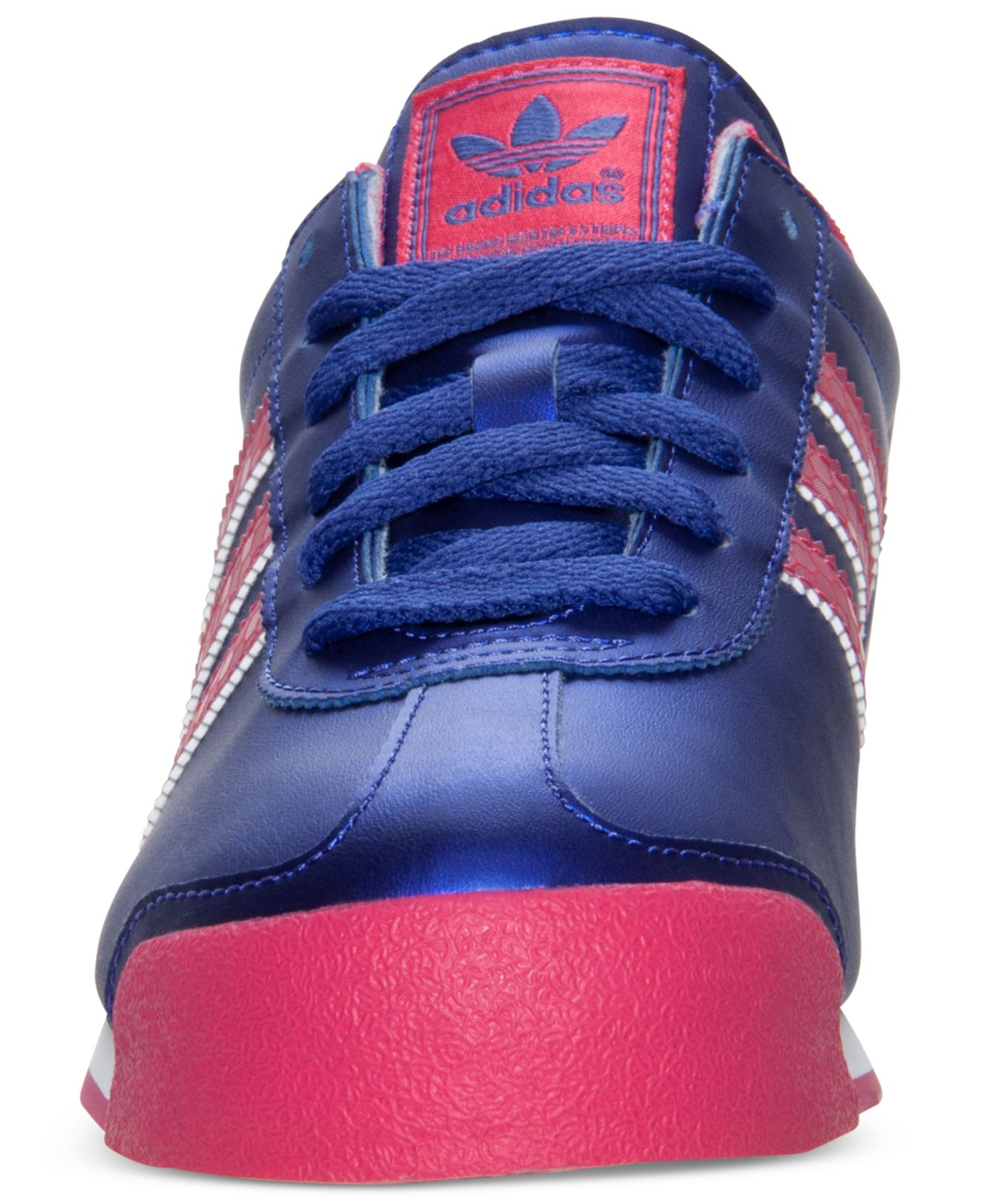 pink and blue adidas samoa