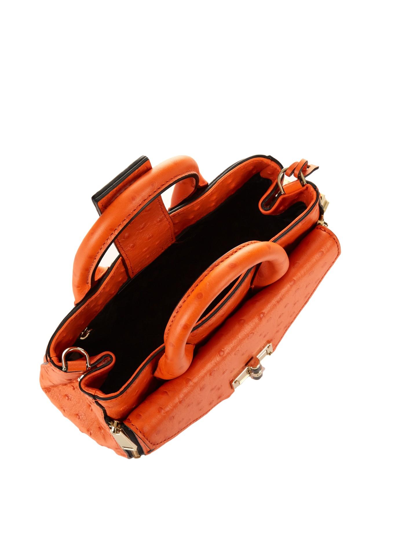 Diane von Furstenberg Leather Mini Secret Agent Cross-Body Bag in Orange