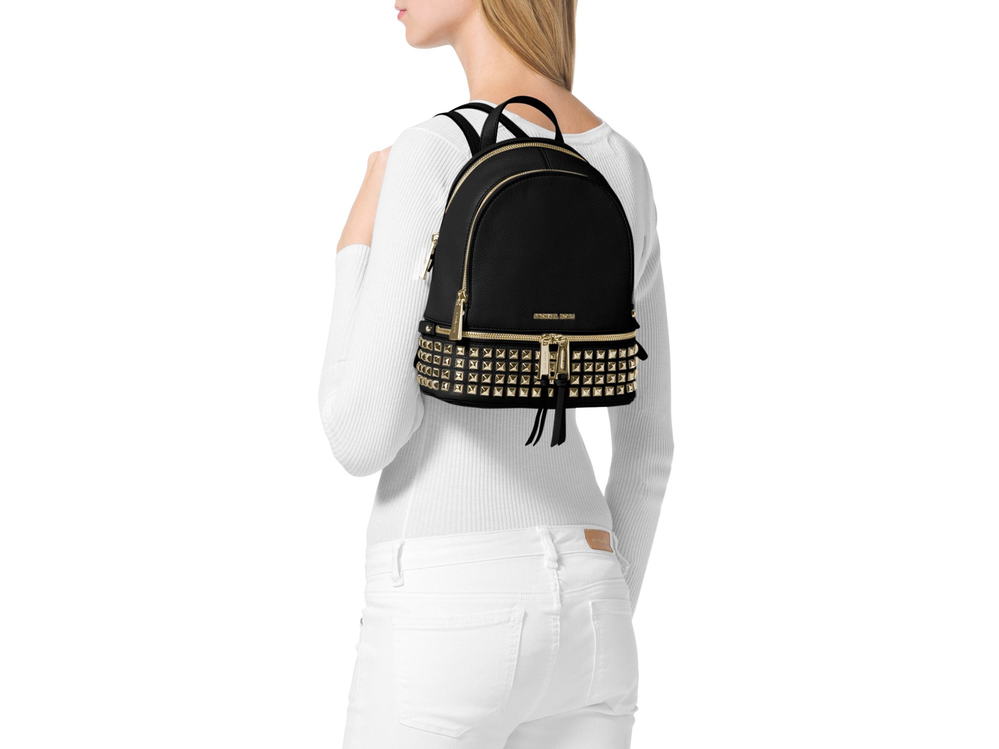 80992c4395 Lyst - MICHAEL Michael Kors Extra Small Rhea Zip Studded Backpack in ...