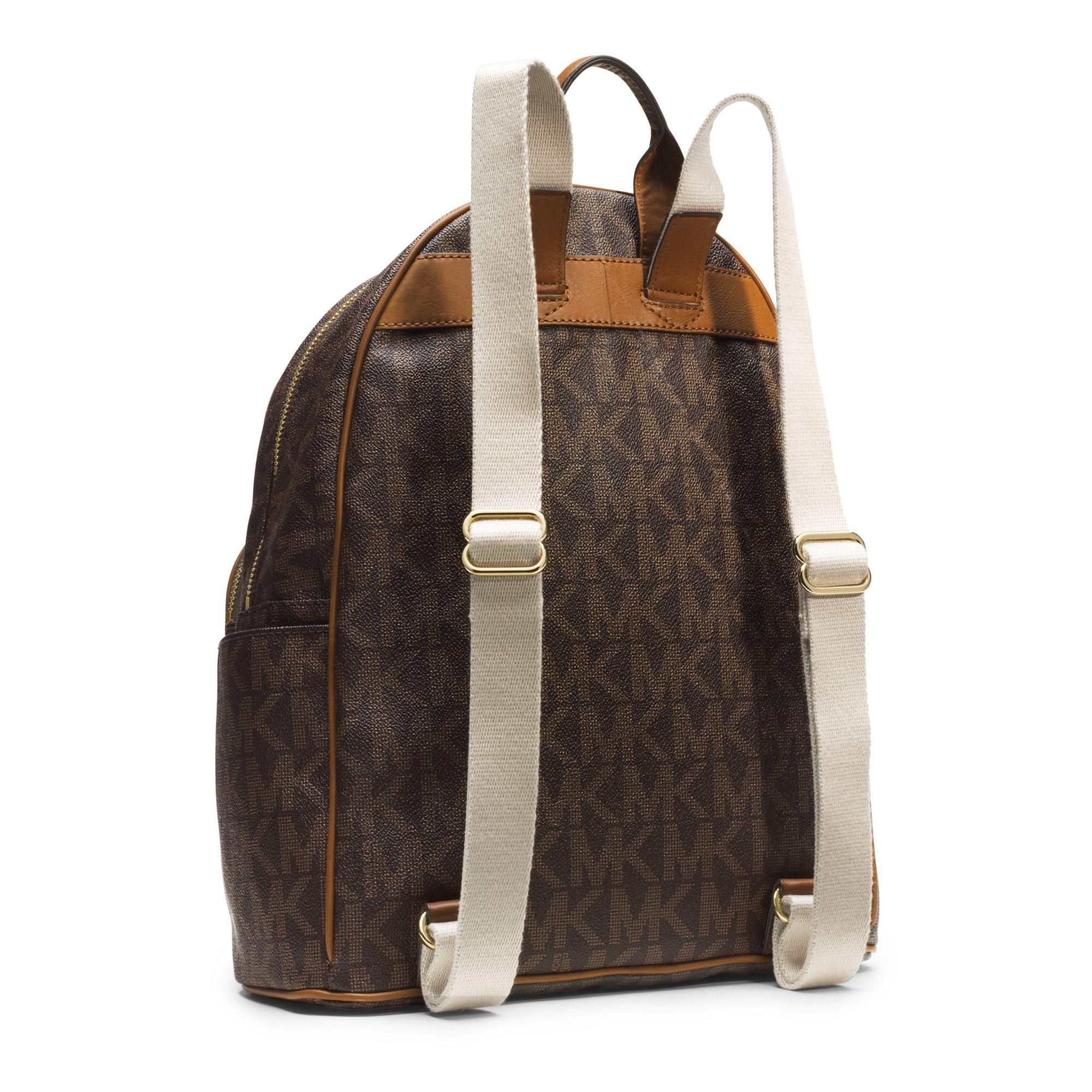 michael kors jet set travel logo backpack in brown lyst. Black Bedroom Furniture Sets. Home Design Ideas