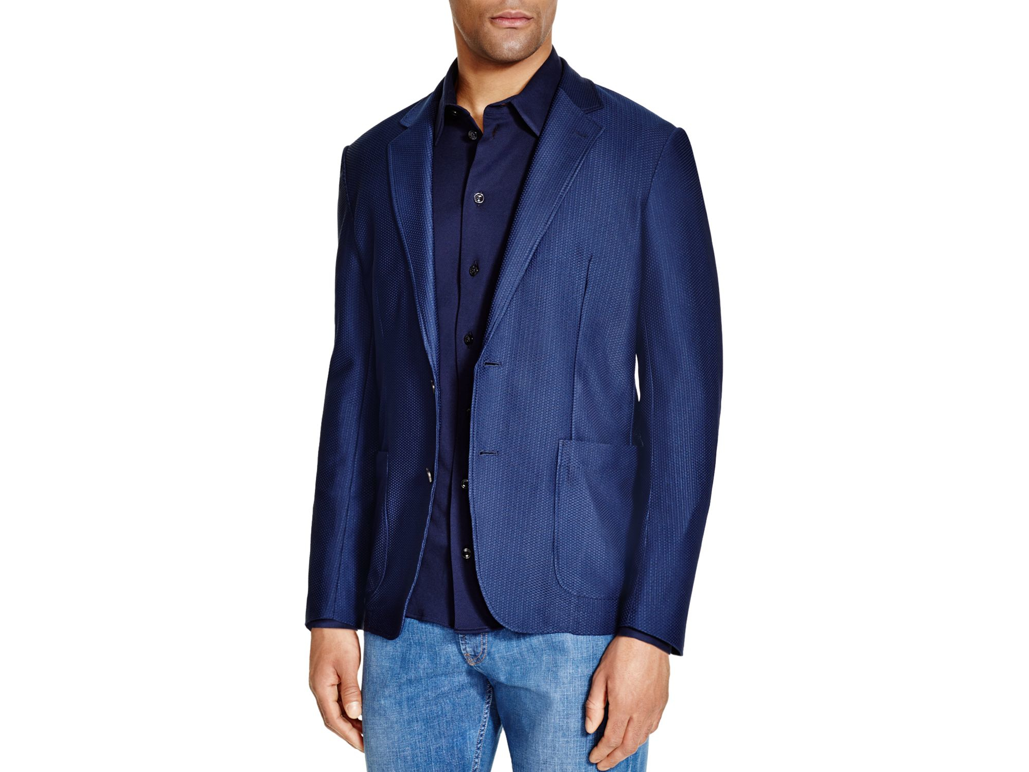 Slim fit jackets are cut closer to the body and fitted more to the client's silhouette. While not restrictive, slim fit is more narrow and has a tighter fit in the arms, waist and chest area in the jacket and in the thigh and waist area in the pants. Tends to look great on .