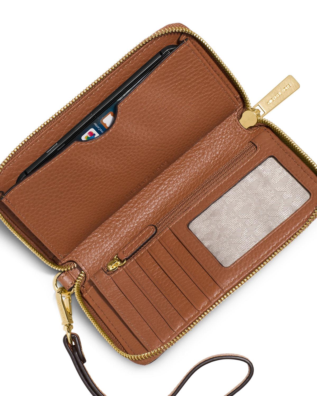 ... kors Fulton Large Flat Multifunction Phone Wallet in Brown : Lyst
