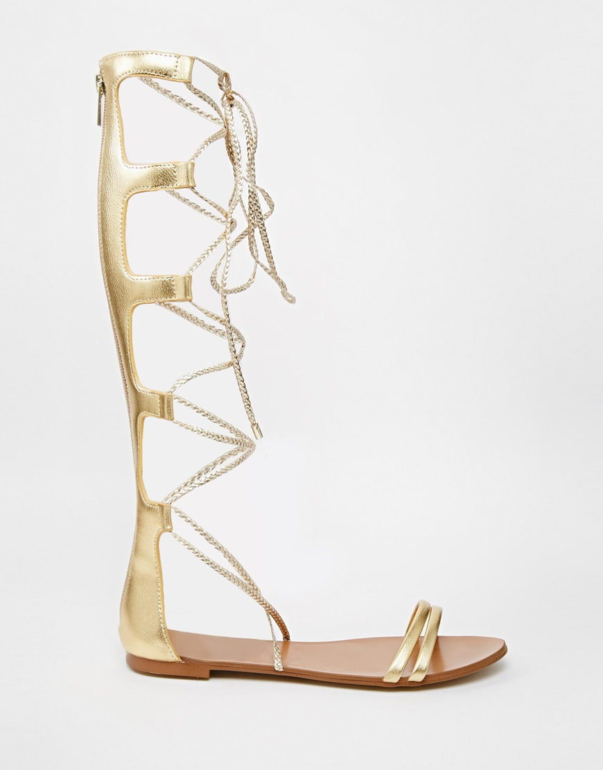 d237d155ff5e Lyst - ALDO Umarelle Gold Knee Gladiator Flat Tie Sandals in Metallic