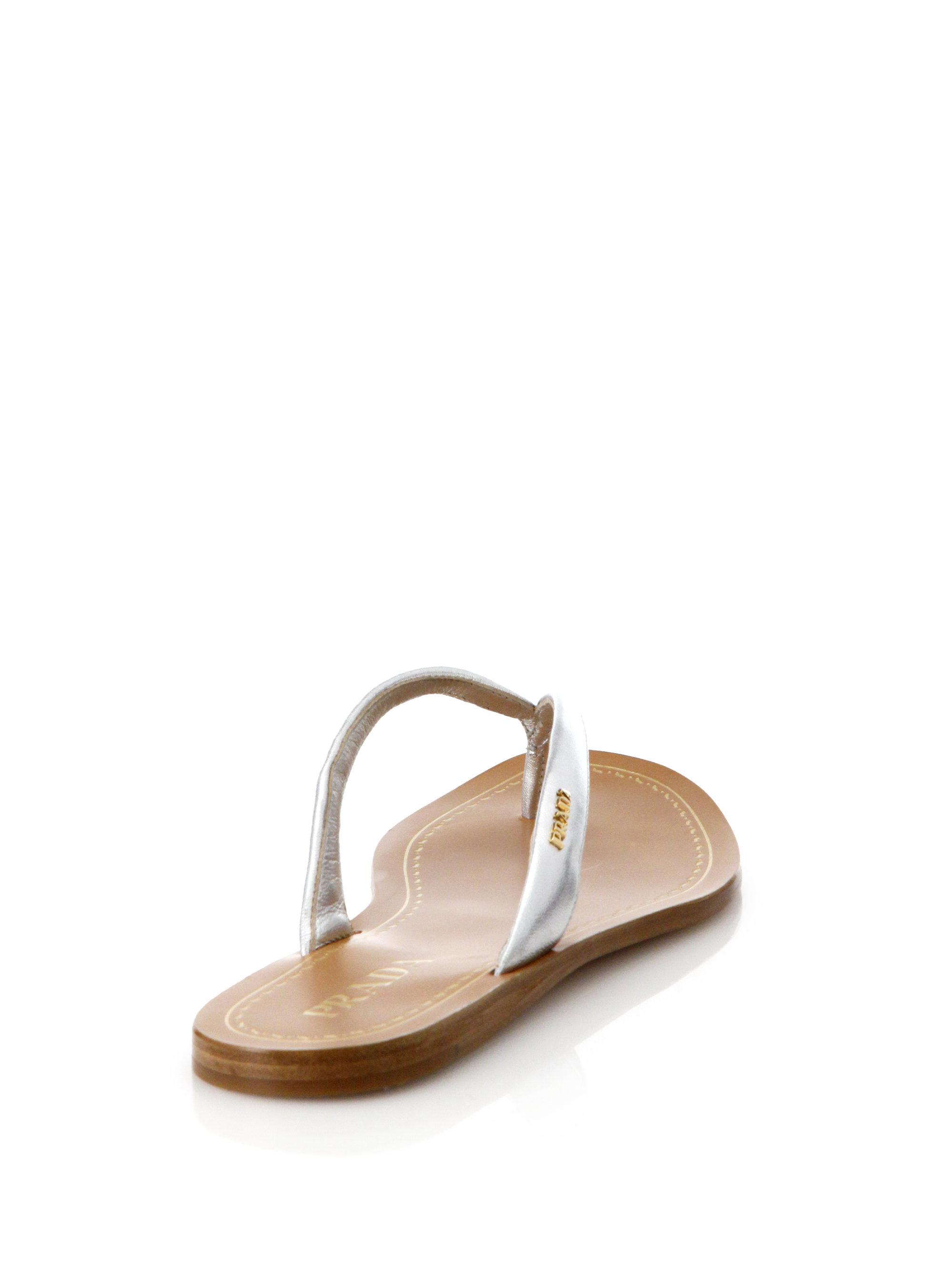 eb6702b83697c5 Lyst - Prada Metallic Leather Logo Thong Sandals in Metallic