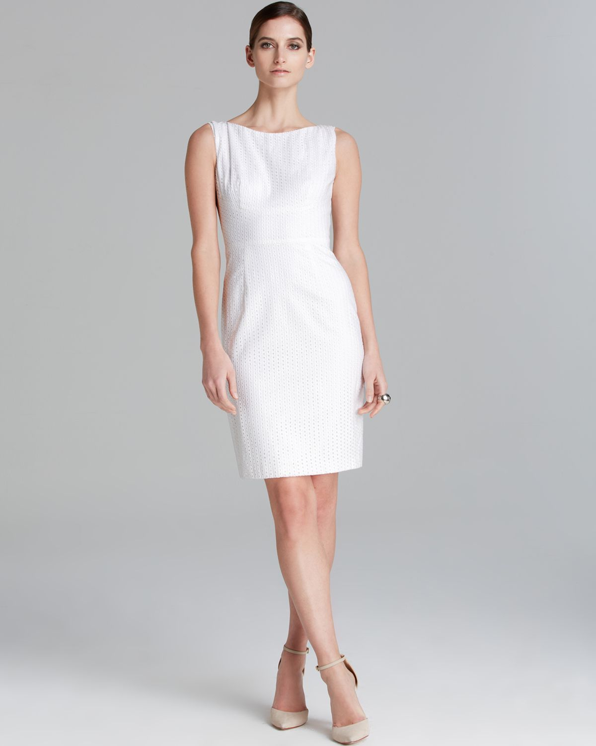 A white sheath dress fits in well at dressy but not overly formal summer events. For a more casual look suitable for festivals or vacation shopping trips, try the breezy, colorful style of Tory Burch dresses.