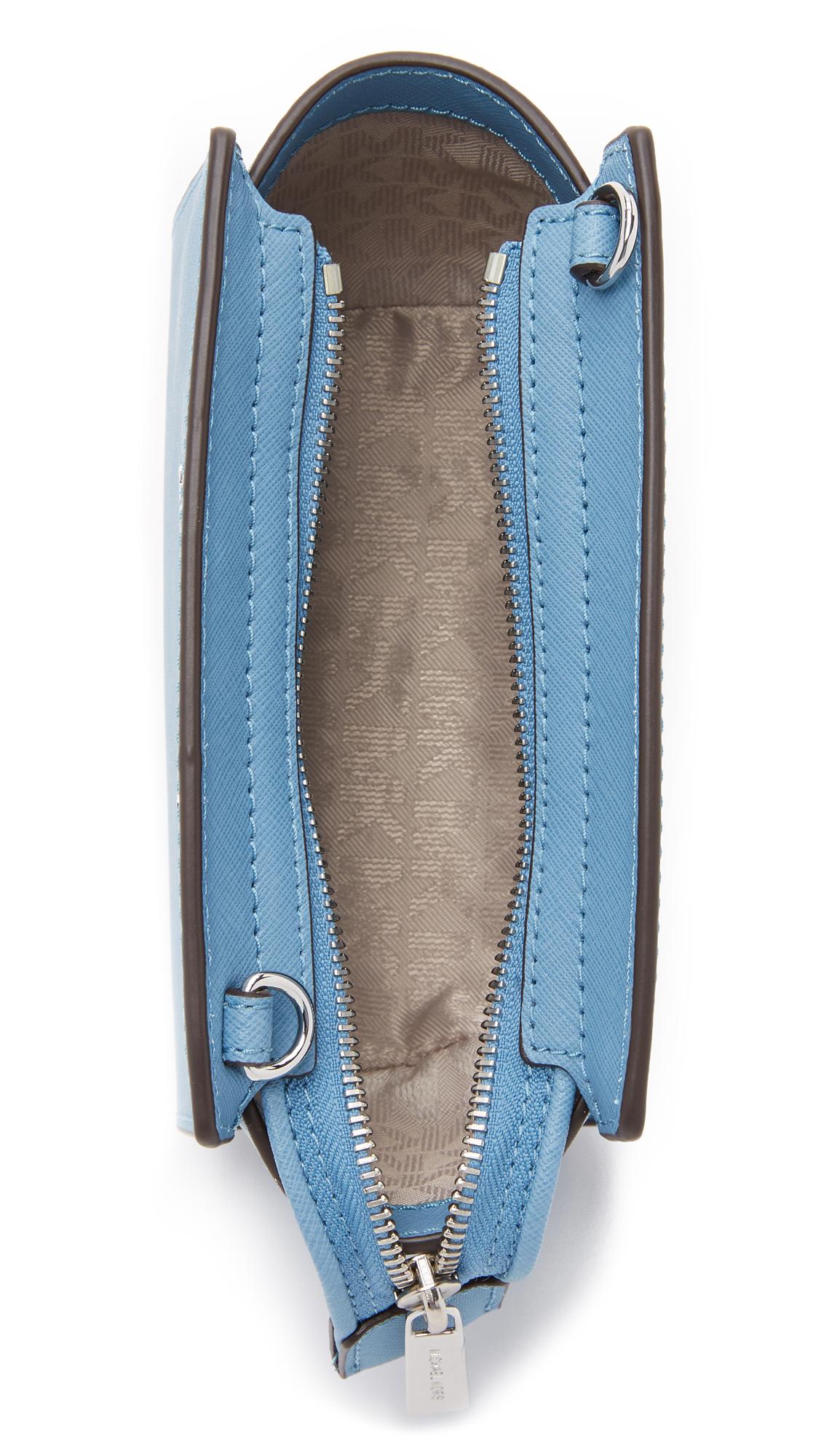 c21afb6079d7cf ... clearance lyst michael michael kors selma mini messenger bag in blue  47f26 9d40d