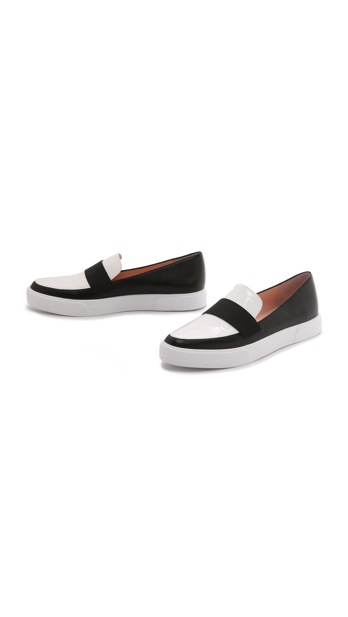 kate spade new york clove slip on sneakers black white