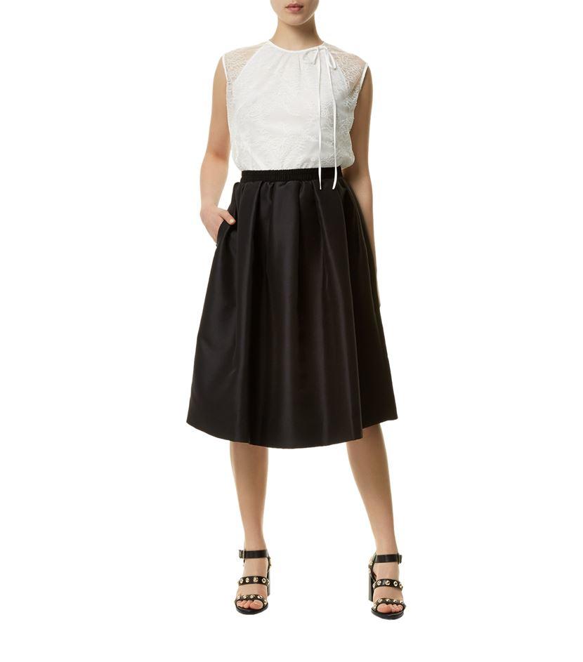 sandro julee flared midi skirt in black lyst