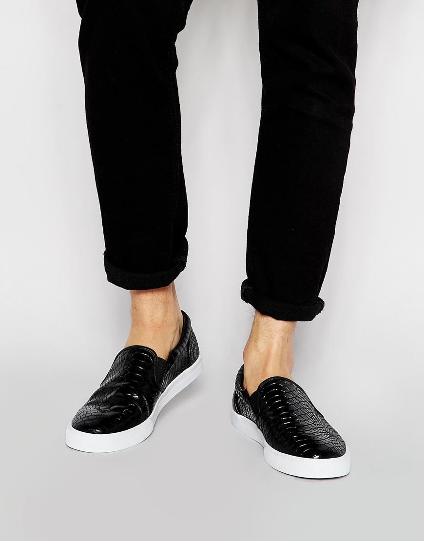 dcfa27954fb ASOS Black Slip On Plimsolls With Snakeskin Effect for men