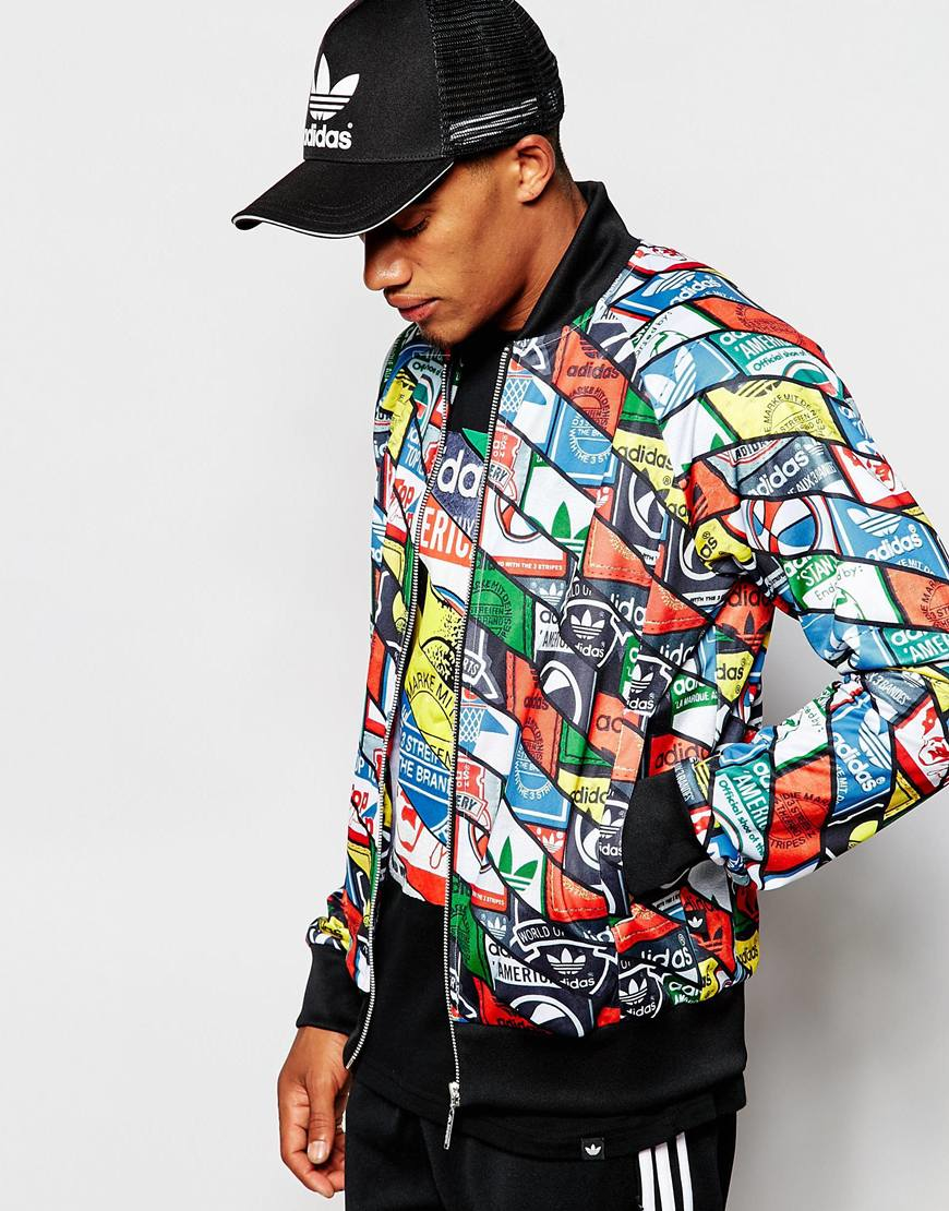 adidas originals all over tongue print superstar track top | black
