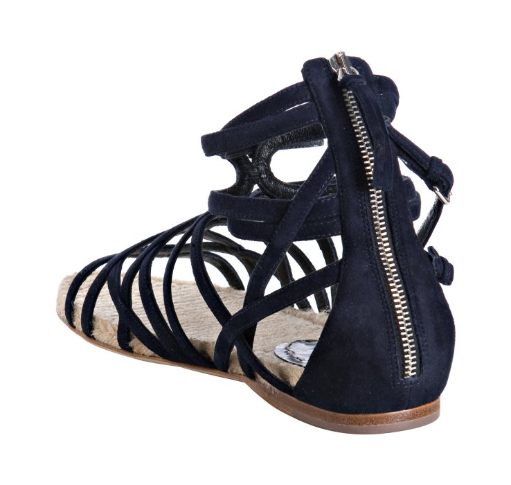 Sandals with toe rings on and black leggings - 1 2