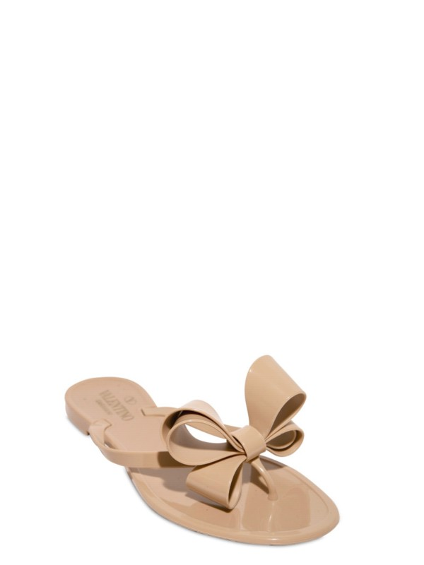 78d949c0a Lyst - Valentino Jelly Bow Flip Flop Flats in Natural