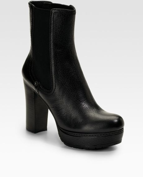 Prada leather lug sole platform ankle boots in black lyst
