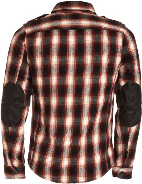 How to Wear a Flannel Shirt for Men. PHOTO CREDIT: Instagram. The flannel shirt has become the epitome of the casual wardrobe. It's a staple piece that every man should own and whether you wear it done up, undone or round your waist it works. Here's our guide on how to style this versatile piece.