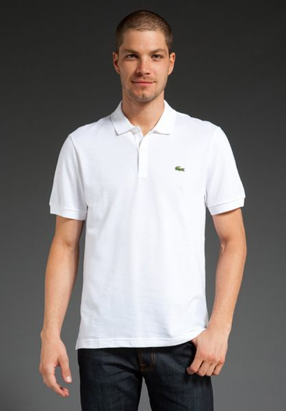 lacoste slim fit solid pique polo in white for men lyst. Black Bedroom Furniture Sets. Home Design Ideas