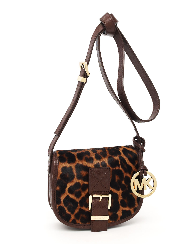 03a97c6b7ff26 ... best price lyst michael michael kors small saddle bag messenger leopard  print 18a7f 7f429