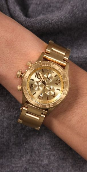 nixon oversized chrono in gold for lyst