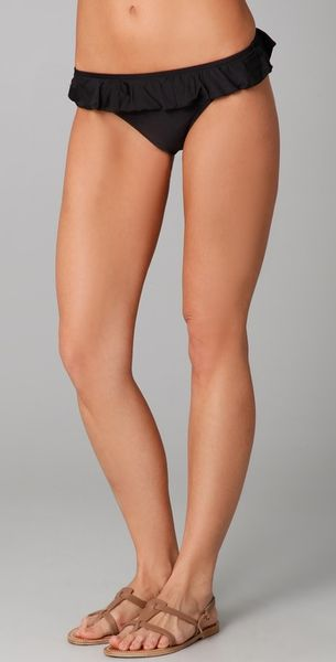 Flirty swim bottoms featuring cinched ruffle edges and ruching at back, Imported.