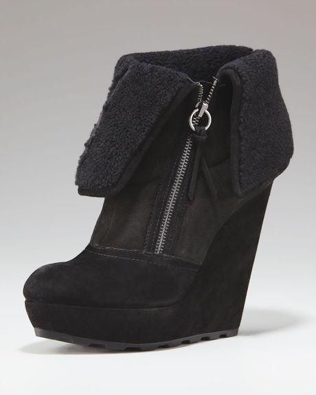 ash cuffed shearling wedge boot in black lyst