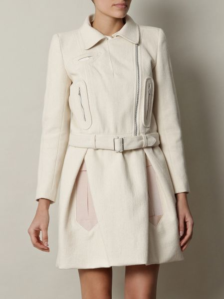 http://cdna.lystit.com/photos/2012/01/25/carven-cream-cotton-biker-jacket-product-4-2772468-882671721_large_flex.jpeg